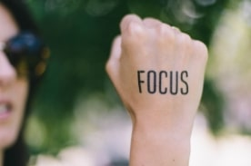 Focus Written on a Hand