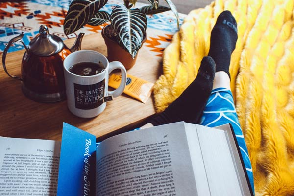 Comfortable, studying from bed with coffee