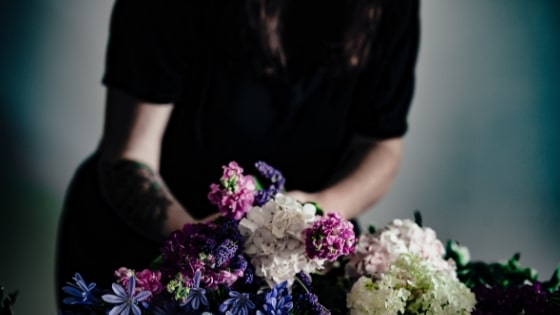 person arranging flowers.