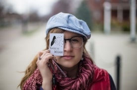 girl hold card that reads dare to dream